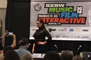 Ashley Graham striking a pose before her presentation.