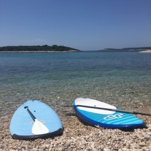 Stand up paddle boards and a view of the islets off of the southern coast of Vis.