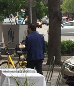 Fred Armisen - walking down the street eating a salad. So Portlandia.
