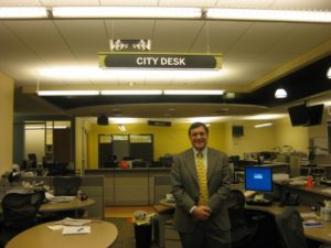 Gil Rudawky at the Rocky Mountain News news desk on the final day of publication