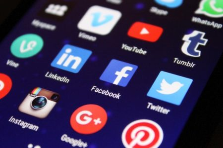 Photo of Social Media Icons on a Mobile Device | Pairing Social Media with Action Ends Slacktivism